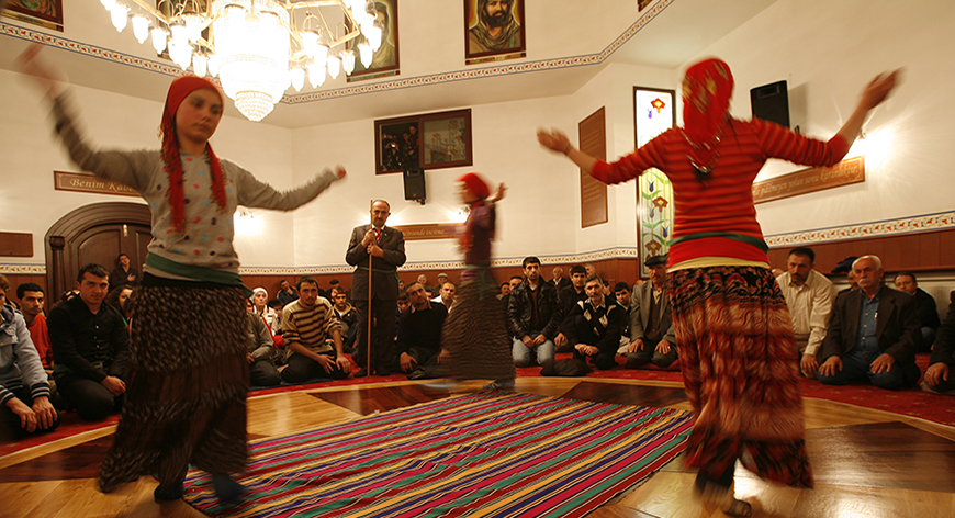 Alevis dance during a prayer in a Cemevi